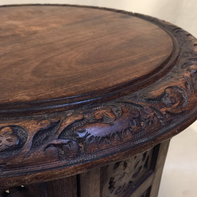 Very authentic Indian carved eight sided round Teak side table. Lovely stain color shows the wood grain. I love boho chic!...
