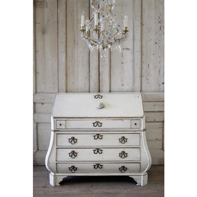 Lovely original painted secretraire in antique white with accents in a gold, and subtle hues of grey peeking through. This...