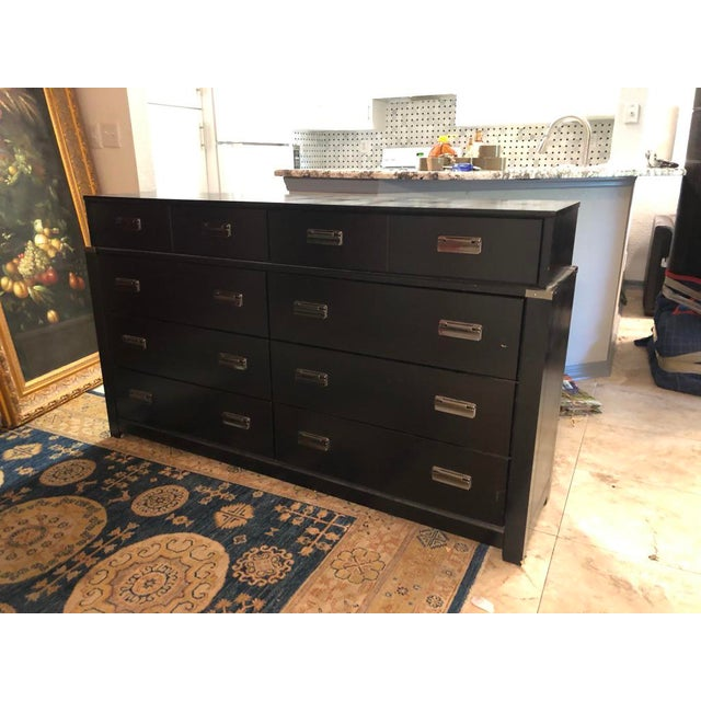 "This Campaign Chest of Drawers in black has 8 drawers the top two are ""set back"" from the rest"