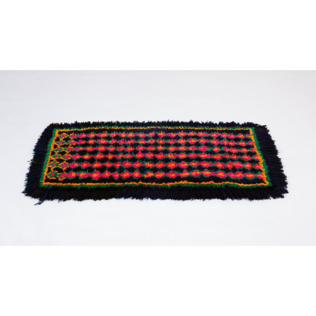 This small rectangular woven textile in bright colors from Peru would make an ideal runner for small spaces, or soft floor...