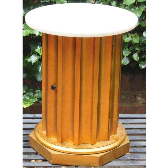 This side table is wood with a painted gold finish with light speckling (see photos). The top is a single piece of round...