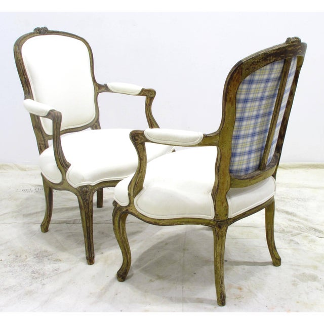 Nice pair of old green painted Louis XV style fauteuils upholstered in white canvas cotton.