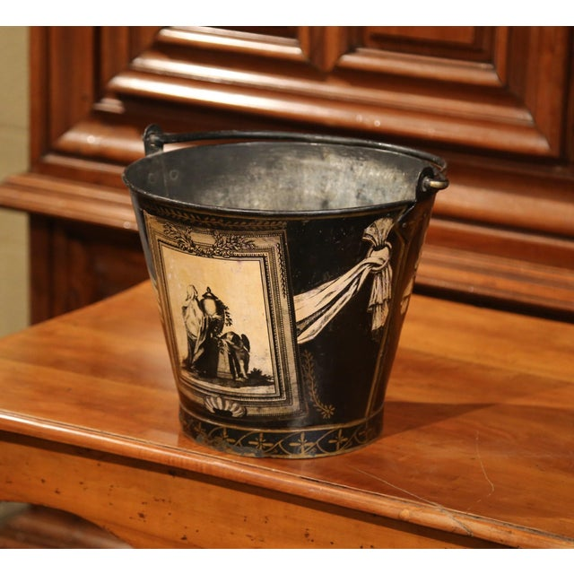 Use this antique bucket as a planter or as a decorative basket in your home; crafted in Paris, circa 1860, the black and...
