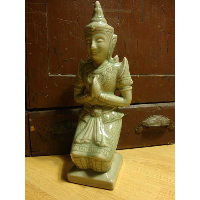 """Here's a beautiful kneeling Buddha figurine that is marked Thai Celadon. It measures 14"""" high This is a wonderful addition..."""
