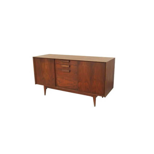 Danish post-war design teak credenza form sideboard with two doors centering three drawers (label: JENS RISOM).