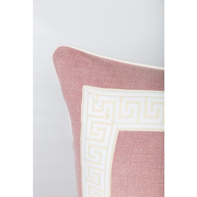 Pair of custom light pink linen pillows with coordinating ivory colored Greek key tape on fronts. Solid light pink linen...