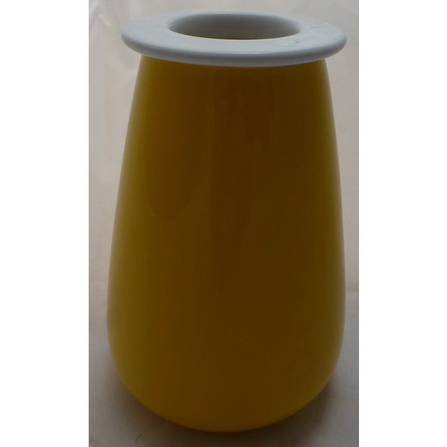 Beautiful color, beautiful form! This pretty yellow Italian pottery vase dates to the Mid-Century and would be perfect...