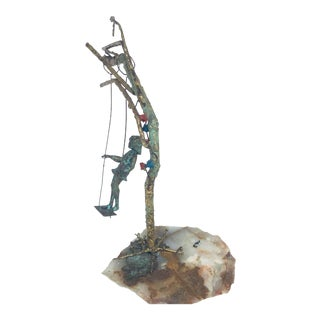 Bronze Figural Sculpted Girl Swinging From a Tree Branch on Marble Rock Base For Sale