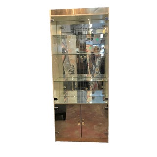 Modern Display Cabinet with Mirrored Doors & Brass Accents