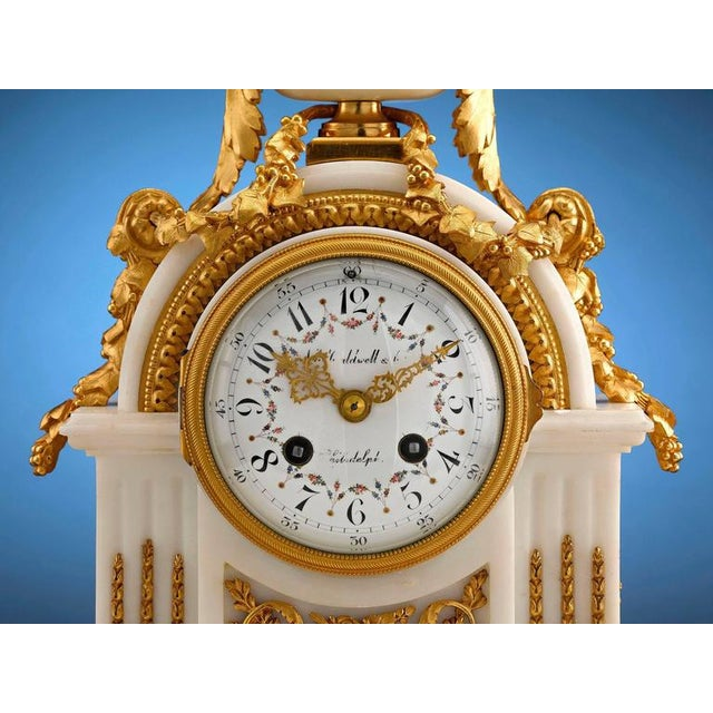This stunning mantel clock by J. E. Caldwell & Co. of Philadelphia exudes tasteful elegance. Crafted of luxurious marble...