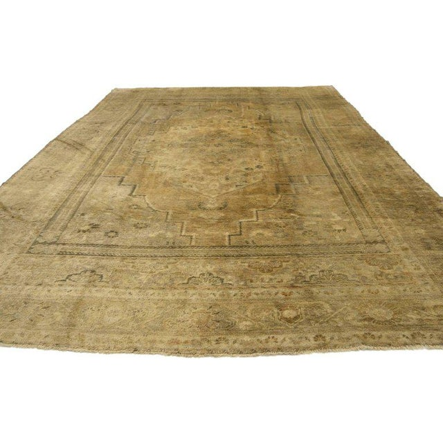 Vintage Turkish Oushak rug with traditional style. This hand-knotted wool piece features a cusped central medallion in an...