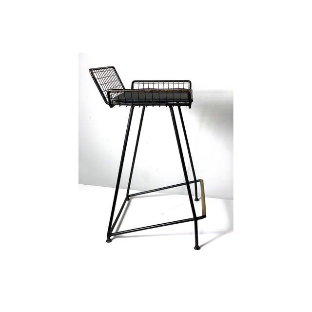 Rare counter height bar stool designed by Tony Paul circa 1950's. Minimalist iron constructions with wire mesh seat, and...