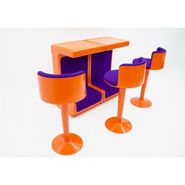 Bar Set by Wolfgang Feierbach consisting of 2 modular counters, 2 wall shelves and 3 rotating bar stools. The furniture is...