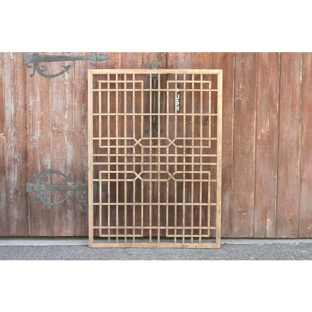 A lovely early 20th century architectural piece with all wooden lattice fretwork and a center geometric interweaving...