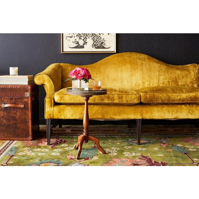 Dramatic citron yellow velvet curvaceous camel back sofa settee made in the Chinese Chippendale taste. Features a shapely...