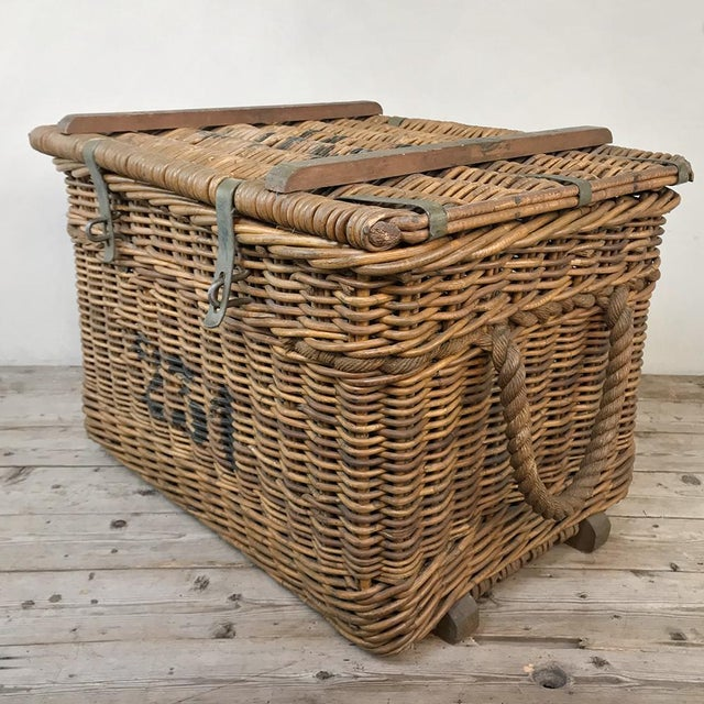 Antique Wicker Basket is an unusual example, with large stenciled numbers, wooden reinforcements and steel hasp locks,...