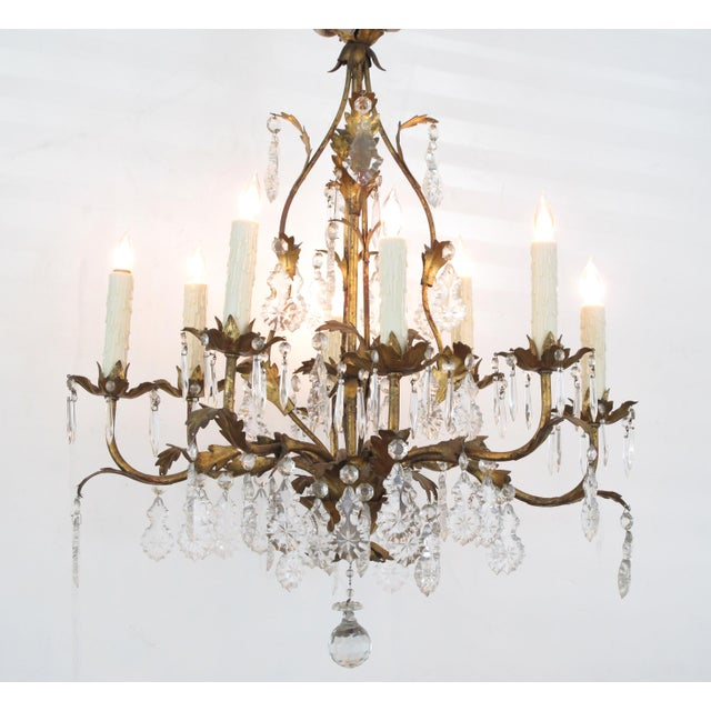 of shapely cage-form emanating 8 scrolling candle arms adorned overall with gilt-tole foliate and crystal pendants