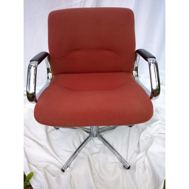 Patton era style Steelcase Accent Chair with chrome base and arms, muted red upholstered seat and arm rests. Seat has...