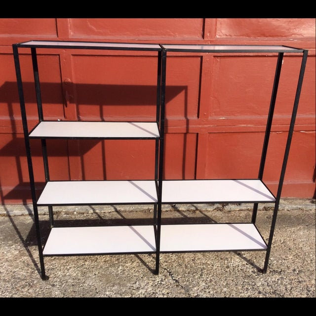 Great wrought iron and painted masonite bookcase. In great vintage condition, with some wear. minor surface rust (mainly...