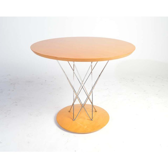 Isamu Noguchi children's size cyclone table by Modernica having chromed steel supports with mahogany base and top. Very...