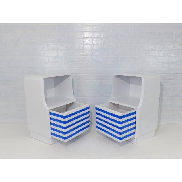 Beautiful petite Mid Century Modern Painted White Nightstands. Elegant Ink Blue stripes on the drawers. Nice clean pop of...
