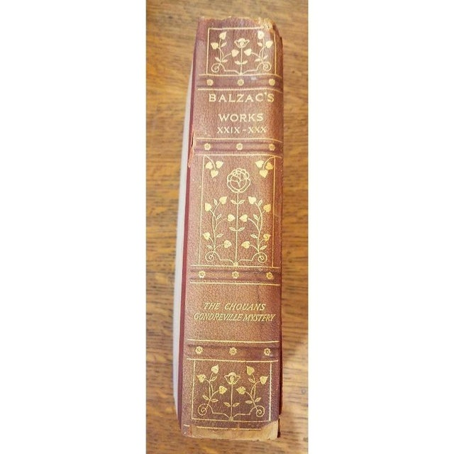 Three-quarters red/brown leather, gilt titles, and tooling to the spine, top edge gilt, gilt ruled to the front and rear...