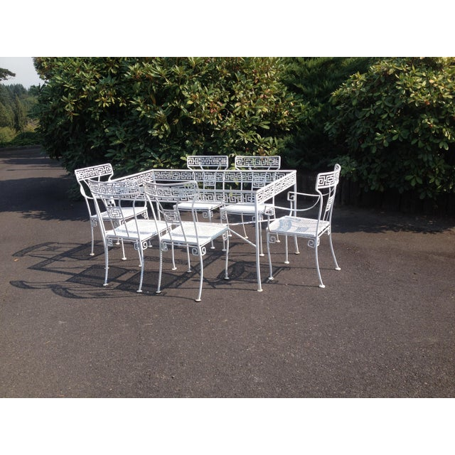 Wonderful vintage Greek Key dining set. Set consists of a table and six (6) chairs. Vintage condition, with wear, some...
