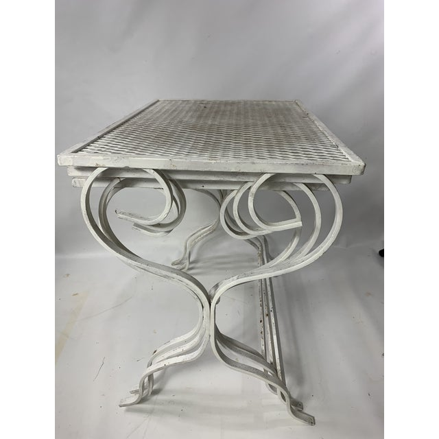 Great set of wrought iron nesting tables designed by Salterini. Made in the 1950sl.