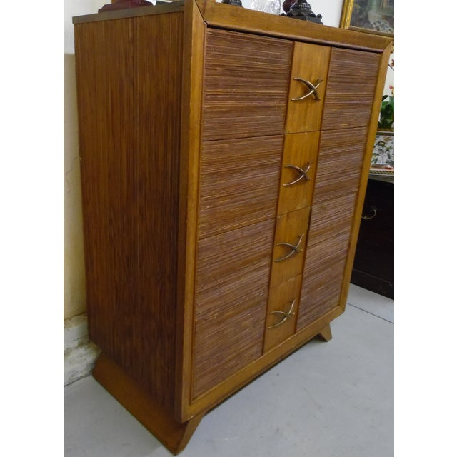 1950's Paul Frankl Combed Wood Chest of Drawers with his Iconic X pulls. The chest of drawers shows some wear but it is...