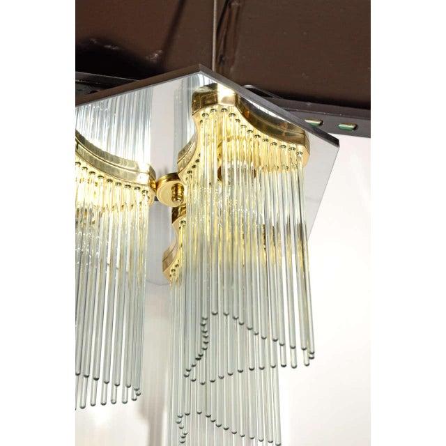 Mid-Century Modern flush mount chandelier designed by Gaetano Sciolari for Lightolier. Chandelier has hexagon frame in...