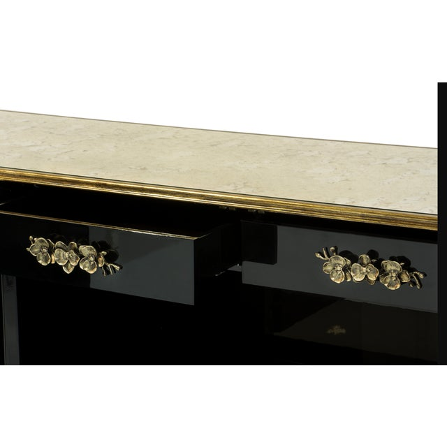 There is a sense of reveal and conceal as KOKET takes a beautiful chest in high gloss lacquer and adorns it in metal...