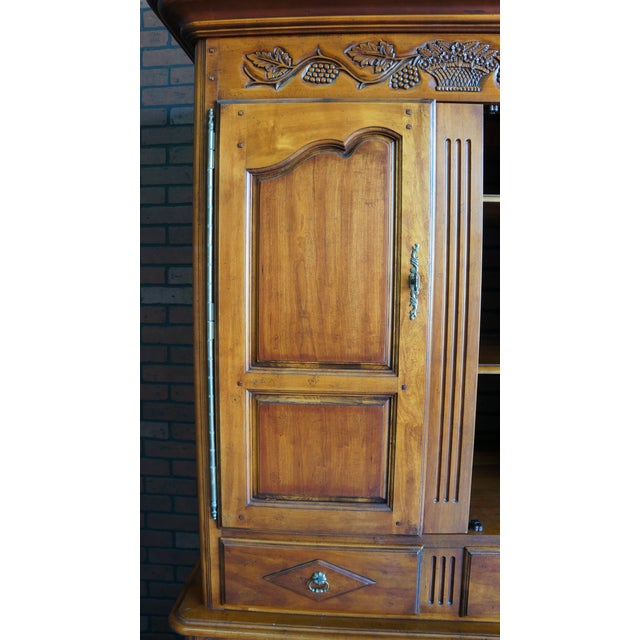 Country French charm and abundant storage come together in this armoire from Hickory Chair. Finely crafted of Cherry with...