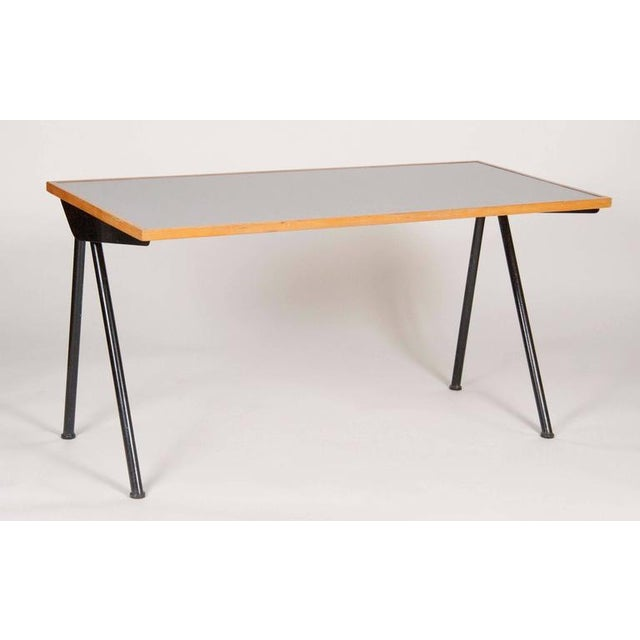 Compass desk design by Jean Prouve in 1953. Produced in 1955 for the Cite Internationale Universitaire. Manufactured by...