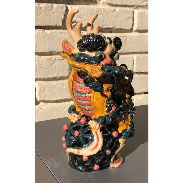 Amazing vintage Chinese foo dog, or lion or dragon. Ceramic with multicolor glaze. Looks as though it was made with a...