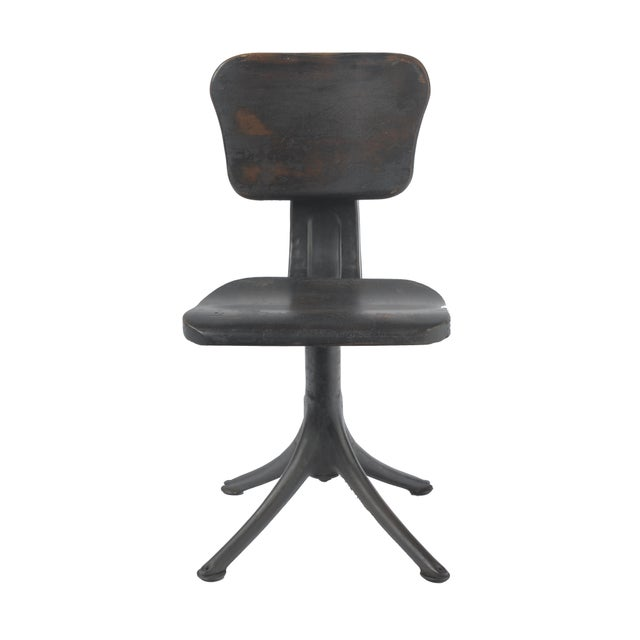 Wonderful small industrial chair with an iron base and wood seat and back. Wood is time worn, giving it a beautiful...