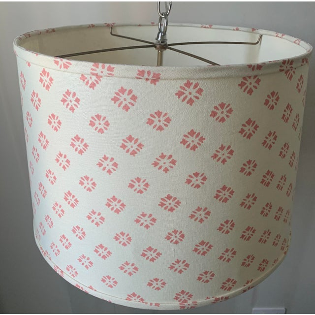 Custom pendant light made from Kathryn Ireland 'Sidone' linen fabric. Cream colored linen with hand printed coral colored...