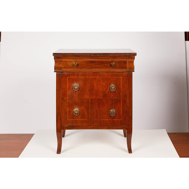 Early 20th Century Neoclassical Italian miniature or commodini made of walnut with a string inlay of satinwood on the top...