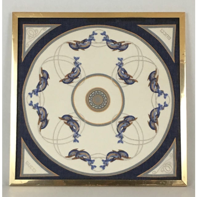Framed vintage Gucci scarf. Chic geometric design with navy and gold dolphin motif. Appears to be made of cotton. Simple...