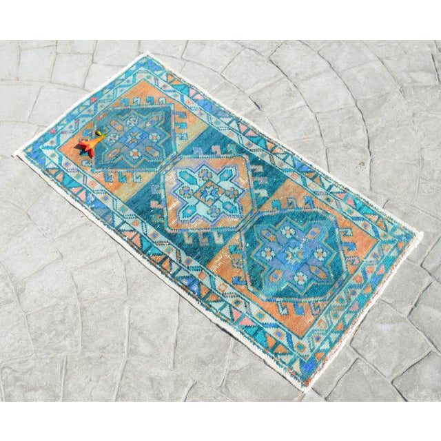 A vintage Turkish small yastik rug, deep cyan - moderate amber background yastik rug perfect for entryway, bath or in...