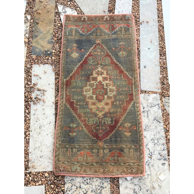 This beautiful rug would complement any floor. The slate color on the spandrels and in the medallion gives a very Ottoman...