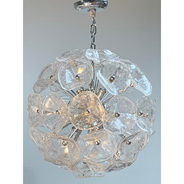 12 light Fiori pendant orb ceiling light featuring a layered round cloister of clear Murano hand blown bubble glass...