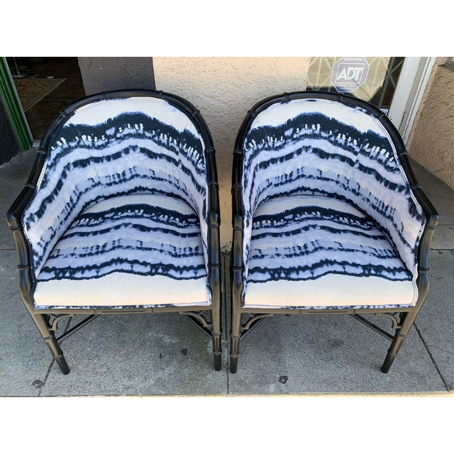 We love these custom upholstered faux bamboo arm chairs. Featuring a high end durable outdoor fabric, these chairs will...
