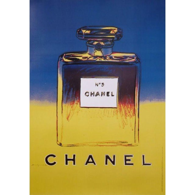 This poster is a reproduction of Andy Warhol's 1985 CHANEL No. 5. The backstory behInd this collection is in 1997 Chanel...