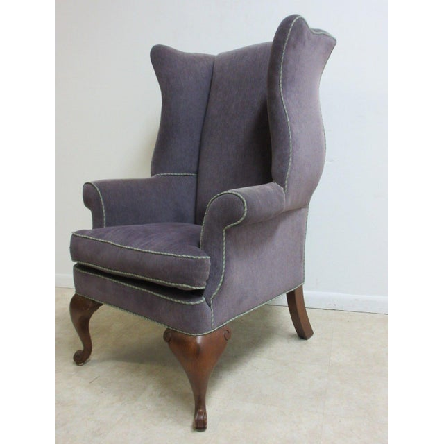 A vintage purple wingback chair. Measurements ( l x w x h) 36 x 33 x 50 seat height 21 arm height 28. Great shape... Minor...