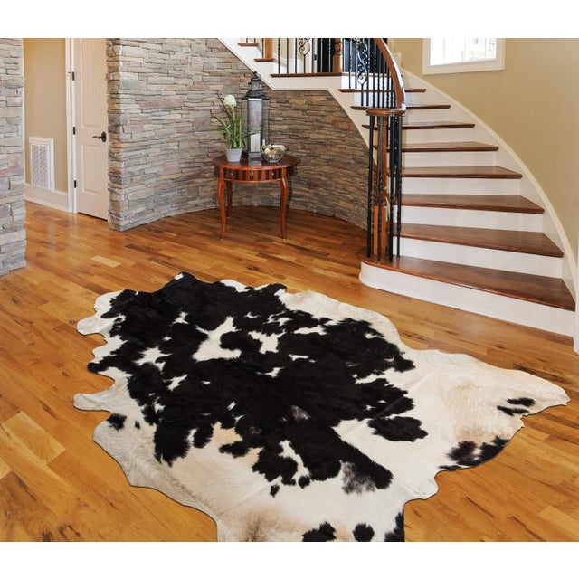 Handmade, luxury, hair-on-hide natural cowhide area rug. KEY FEATURES • Hand Made in Europe • Hand-Made by 3rd. generation...