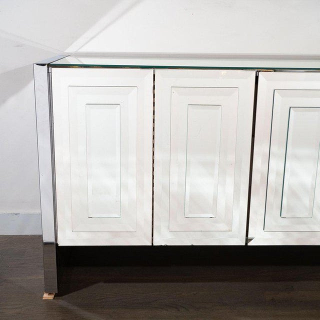 This stunning Mid-Century Modern mirrored and chrome sideboard was realized by the celebrated design firm Ello, in the...