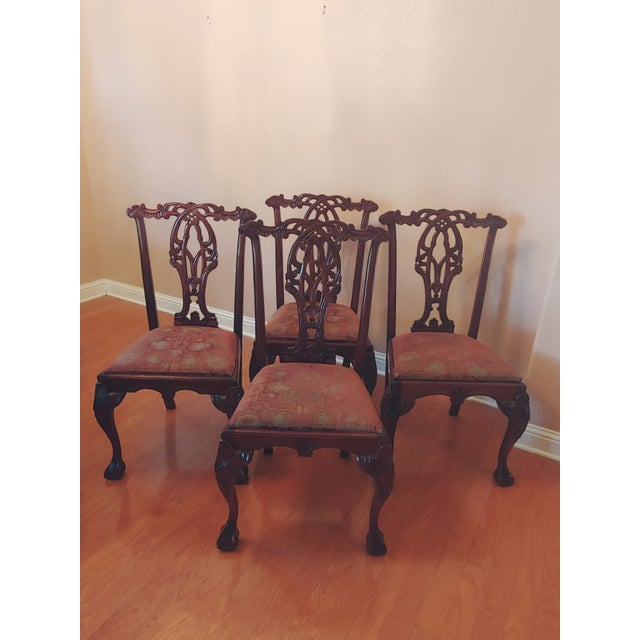 A strikingly graceful set of six solid mahogany Chippendale-style dining chairs in excellent condition! The set now...