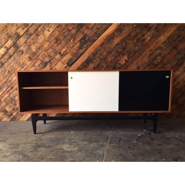 Mid Century Style Custom Credenza. It features sliding doors and plenty of storage space! Dimensions: L:71 W:16 H:30.5