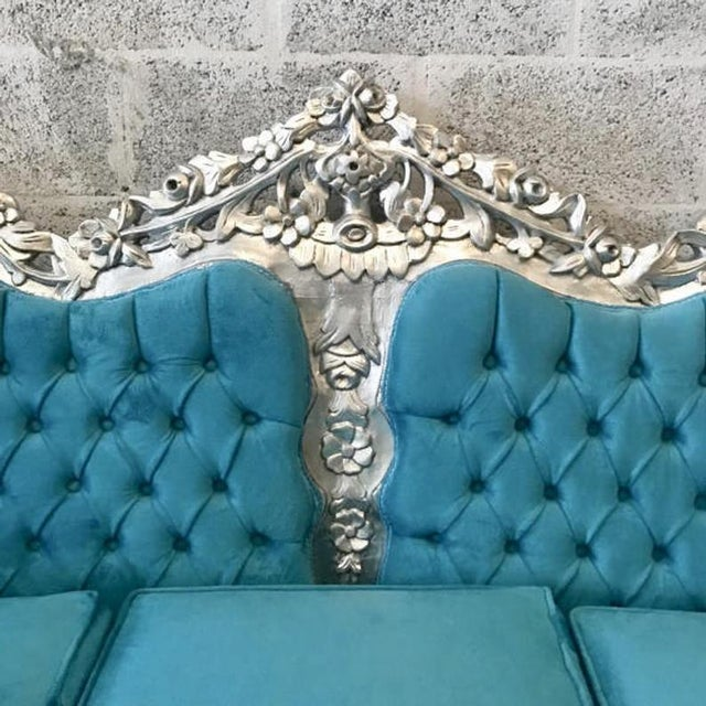 Italian Baroque style sofa refinished in Italy and reupholster tufted using a blue velvet fabric. The frame is recently...