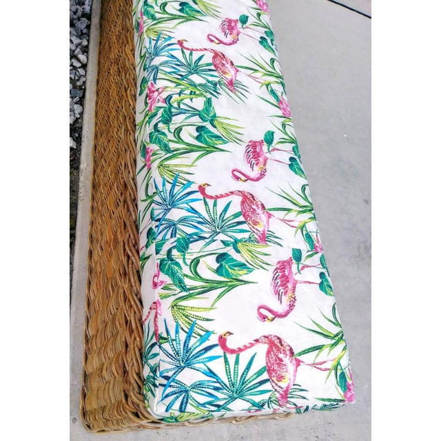 Beautiful extra long wicker bench with newly custom upholstered large tropical flamingo cushion top. This is truly a piece...